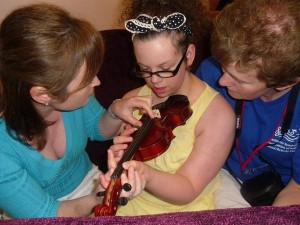Kelsey plays the violin